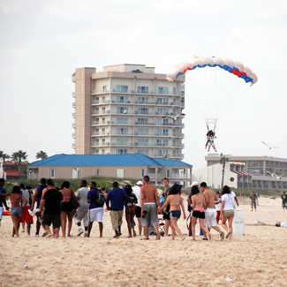 South Padre Sky divers and college students on the beach