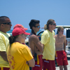 Life Guards Watching Kiteboarding Intently